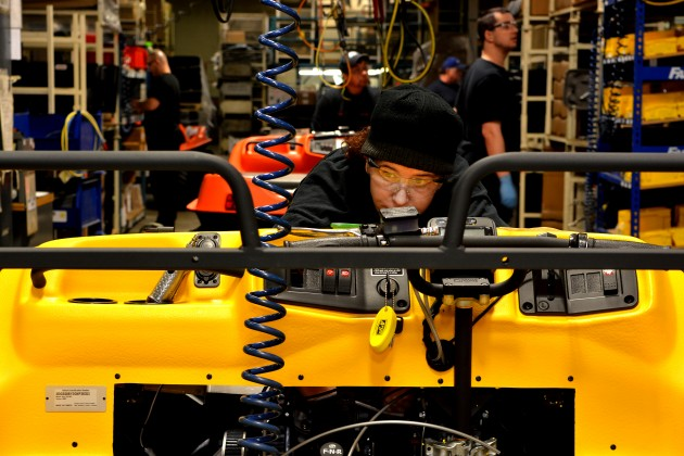 Assembly worker Susan Dixon wires an ARGO engine before testing. PHOTO: STEPHEN UHRANEY