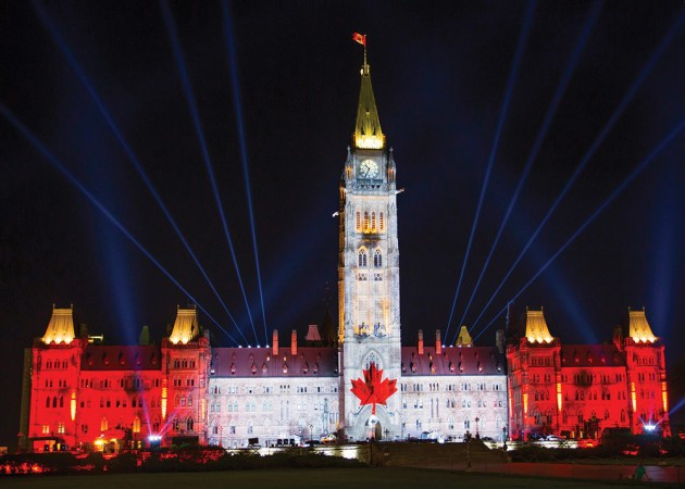 Parliament Hill lit up by the Northern Lights Sound and Light Show. PHOTO: DEPARTMENT OF CANADIAN HERITAGE