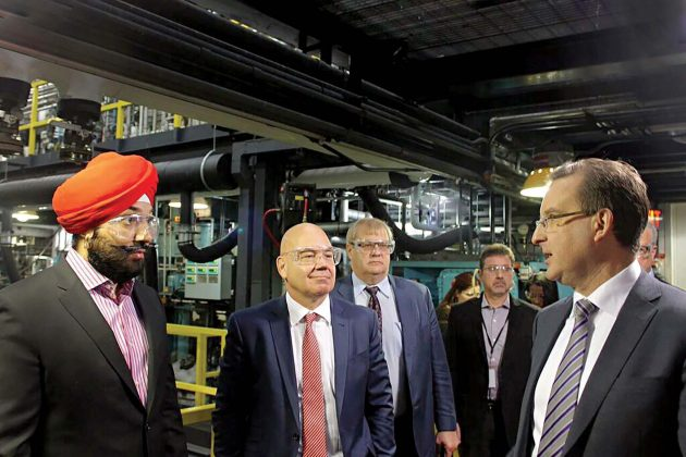 Navdeep Singh Bains, minister of innovation, science and economic development (left), visits the Xerox Research Centre of Canada facility in Mississauga, Ont. He's joined by Al Varney, president and CEO of Xerox Canada (centre) and Dr. Paul Smith, vice-president of XRCC (right). PHOTO: XRCC